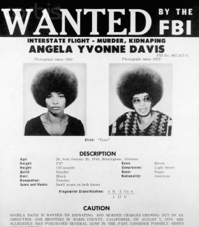 "19 Aug 1970 --- Original caption: 8/19/1970-Washington, DC -Angela Yvonne Davis, a self admitted communist, has been added to the FBI's list of ""Ten Most Wanted Fugitives."" The FBI issued this wanted flyer August 18. She is charged with unlawful flight to avoid prosecution for murder and kidnapping. Several weapons allegedly used by Jonathan Peter Jackson in the San Rafeal, California, courthouse shoot-out recently were reportedly purchased by Miss Davis. --- Image by © Bettmann/CORBIS"